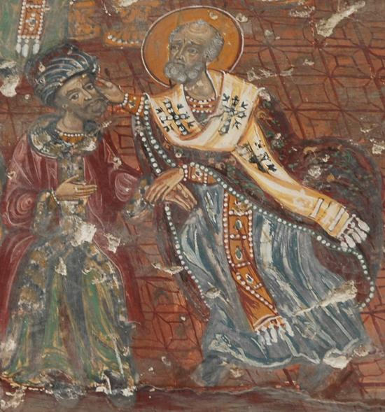 St Nicholas of Myra slapping Arius at the Council of Nicaea.  Fresco at Soumela.  By Marco Prins. Via Livius.org.